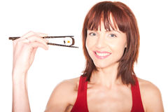 Woman Holding Chopsticks With Sushi Stock Photography