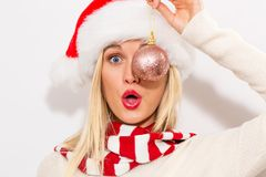 Woman holding Christmas bauble Royalty Free Stock Photos