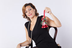 Woman holding christmas bell Stock Photography