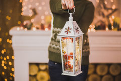 Woman holding Christmas decor in hands Stock Image
