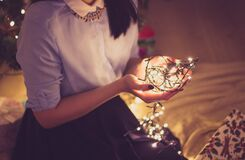 Woman holding Christmas decoration Stock Photography