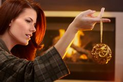 Woman holding christmas decoration Royalty Free Stock Photography