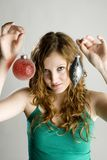 Woman holding Christmas decorations Stock Images