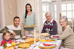 Woman holding christmas dinner with family at dinning table Stock Photography