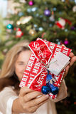 Woman holding Christmas Gift Stock Photo