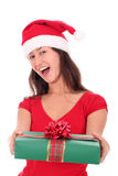 Woman holding christmas gift. Woman in Santa hat holding Christmas gift Royalty Free Stock Image