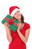 Woman holding christmas gift. Woman in Santa hat holding Christmas gift Stock Images