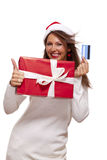 Woman holding a Christmas gift and bank card Stock Image