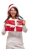Woman holding a Christmas gift and bank card Royalty Free Stock Image