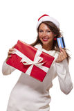 Woman holding a Christmas gift and bank card Stock Images