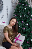 Woman holding Christmas gift-box Royalty Free Stock Photo