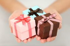 Woman holding Christmas gifts Stock Image
