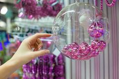 Woman holding Christmas glass bowl with small pink Stock Photo