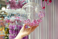 Woman holding Christmas glass bowl with small pink Stock Images
