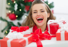 Woman holding Christmas present boxes Stock Photos