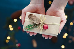 Woman holding Christmas present Stock Images