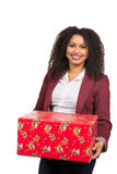 Woman is holding a christmas present Stock Photo