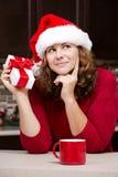 Woman holding Christmas present Stock Photo