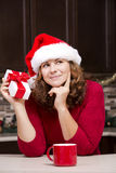 Woman holding Christmas present Stock Photo