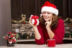 Woman holding Christmas present Royalty Free Stock Photo