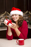Woman holding Christmas present Stock Photography
