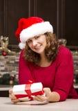 Woman holding Christmas present Royalty Free Stock Image