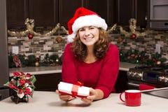 Woman holding Christmas present Royalty Free Stock Photos
