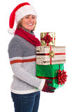 Woman holding Christmas presents isolated. A woman wearing a Santa Claus hat holding some gift wrapped Christmas presents, isolated on a white background Stock Image