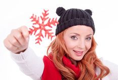 Woman holding christmas red star Royalty Free Stock Images