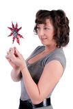 Woman holding christmas toy Stock Photos