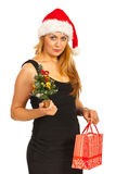 Woman holding Christmas tree and gift Royalty Free Stock Image