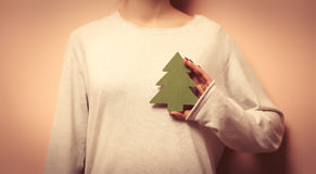 Woman holding a christmas tree shape toy Stock Photography