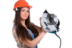 Woman holding circ saw 1. Young woman in orange helmet holding buzz saw royalty free stock image