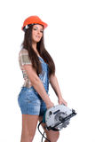 Woman holding circular saw. Young woman in orange helmet holding buzz saw royalty free stock photo