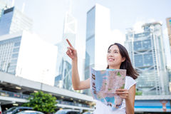 Woman holding city map and finger pointing up Royalty Free Stock Photo