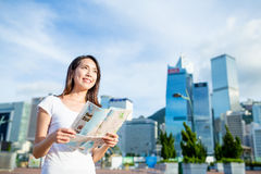 Woman holding city map Stock Images