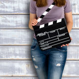 Woman holding a clapboard Royalty Free Stock Photo