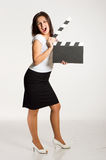 Woman holding a clapper Royalty Free Stock Photos