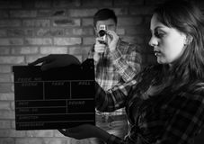 Woman Holding Clapper Board In Front Photographer Stock Image