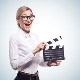 Woman holding clapper board in her hands Stock Photos