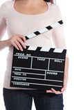 Woman holding clapperboard Royalty Free Stock Image