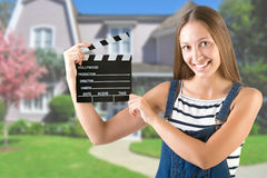 Woman Holding a Clapperboard Stock Photos
