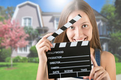 Woman Holding a Clapperboard Royalty Free Stock Photography