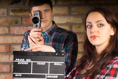 Woman holding a clapperboard Stock Images