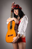 Woman holding classic guitar Royalty Free Stock Image