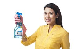 Woman holding cleaning fluid Stock Photo
