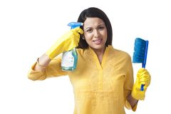 Woman holding cleaning product Royalty Free Stock Image