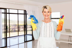 Woman holding cleaning products Royalty Free Stock Photo