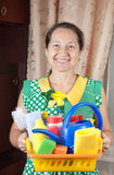 Woman holding cleaning supplies Royalty Free Stock Photo