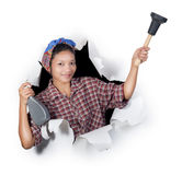Woman holding cleaning supplies Royalty Free Stock Image